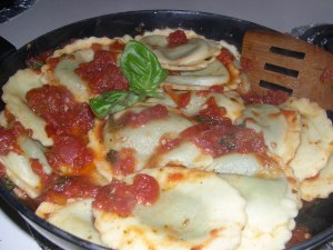 Spinach and ricotta ravioli with Lucini Tomato-Basil sauce
